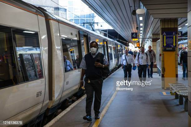 Commuters get off a train at Fenchurch Street railway station in the City of London, U.K., on Friday, May 29, 2020. For the last 11 weeks, Europe's...