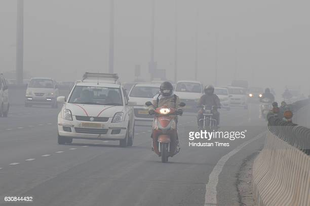 Commuters had a tough time travelling on the DelhiGurgaon Expressway because of dense fog on January 3 2017 in Gurgaon India The minimum temperature...