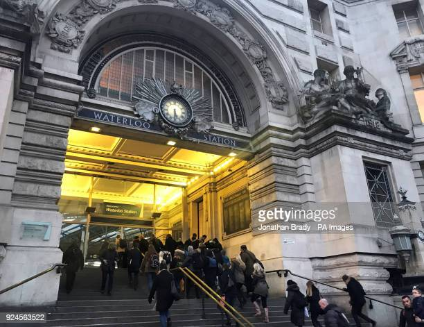 Commuters head into Waterloo Railway Station London as they make their way home during the evening rush hour ahead of warnings from railway companies...