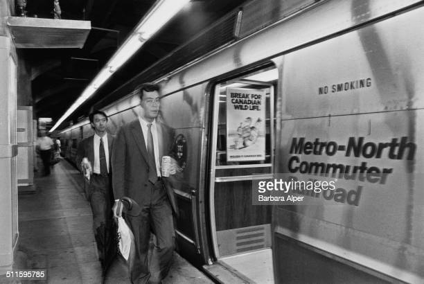 Commuters heading home to Scarsdale from Grand Central Station in New York City, on the Metro-North Commuter Railroad, 13th August 1990.