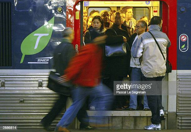 Commuters huddle together in a train at Saint Lazare railway station in central Paris as French rail workers stage a strike January 21 2004 in...