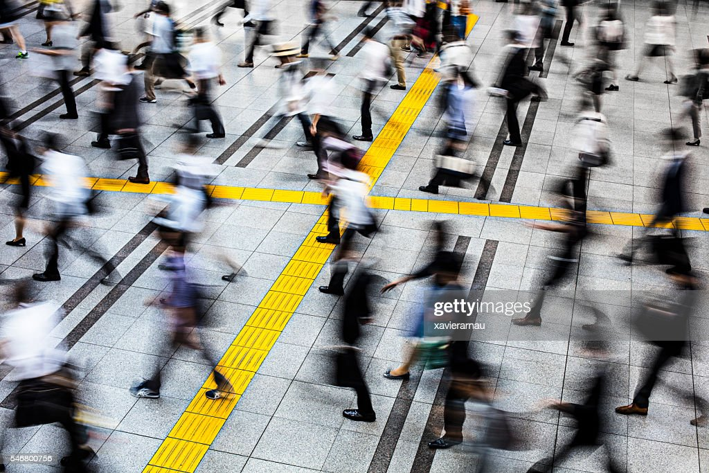 Commuters in a station at Tokyo : Stock Photo