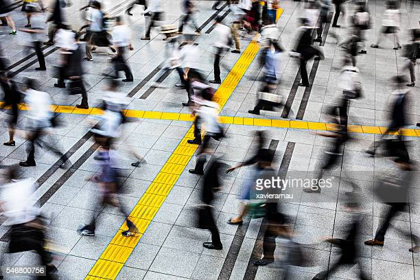 commuters in a station at tokyo - tokyo station stock photos and pictures