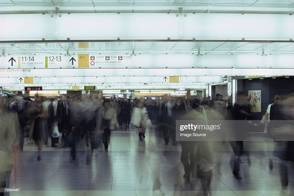 Commuters in railway station : Stock Photo