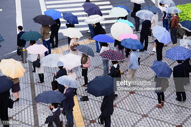 commuters in rain - chiba city stock pictures, royalty-free photos & images