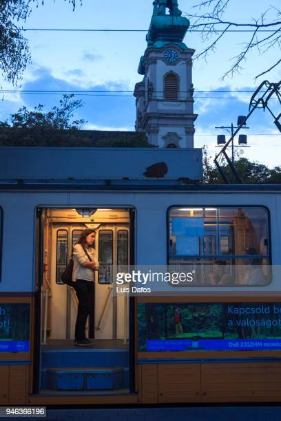 commuters inside cable car at night in budapest - dafos stock photos and pictures
