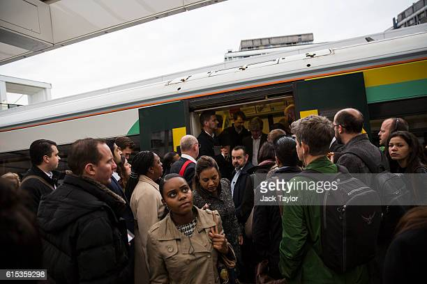 Commuters leave a Southern rail train at East Croydon station on October 18 2016 in London England Staff at Southern rail have begun a second...