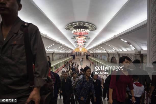 TOPSHOT Commuters leave a subway train platform of the Pyongyang metro on September 22 2016 / AFP / Ed JONES