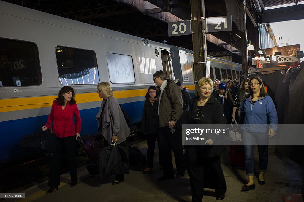 Commuters leave a VIA Rail train at Union Station, the heart of VIA Rail travel, on April 22, 2013 in Toronto, Ontario, Canada. The Royal Canadian Mounted Police (RCMP) report they have arrested two people connected to an alleged Al Qaeda plot to detonate a bomb on a VIA Rail train in Canada.