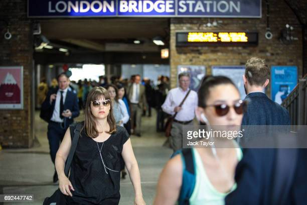 Commuters leave London Bridge Underground Station after it was reopened following the June 3rd terror attack on June 5 2017 in London England Seven...