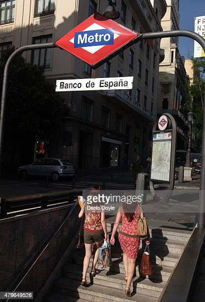 Commuters leave the Banco de Espana Metro station beside the Bank of Spain headquarters a day after Greeks voted in a referendum to reject the...