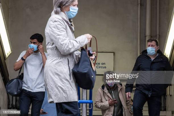 Commuters leave the underground network during rush hour on July 06, 2021 in London, England. The UK government will no longer compel mask-wearing in...