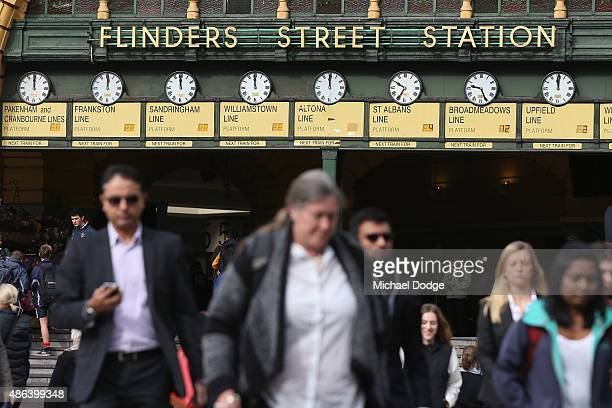 Commuters leave their train at Flinders Street Station shortly before Train Union workers start their strike on September 4 2015 in Melbourne...
