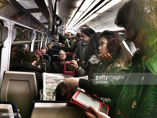 Commuters line the aisle of a packed train bound for paddington station during a tube strike