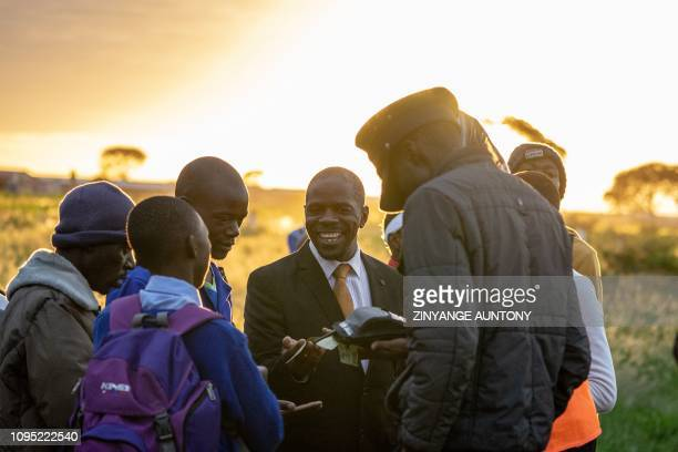 Commuters make payments to purchase commuter train tickets on January 29, 2019 in Cowdray Park township, in Bulawayo, Zimbabwe. - Zimbabwe's only...