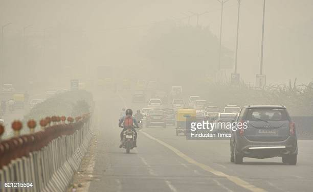 Commuters make their way in dense smog as the whole city is engulfed in heavy smog air quality deteriorated sharply overnight leading to poor...