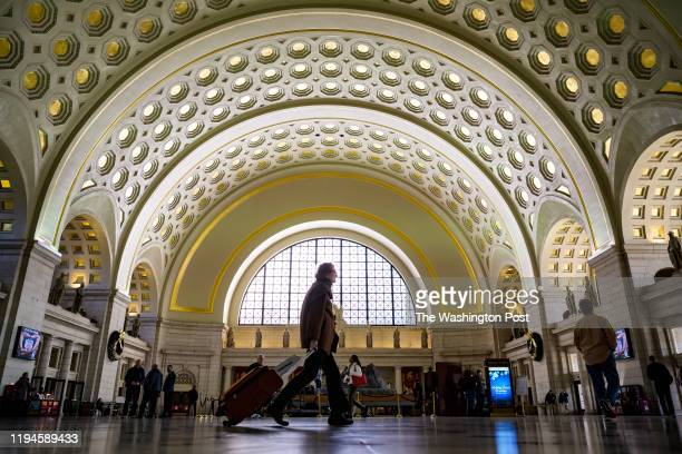 Commuters make their way into and out of the Washington Union Station during the busy holiday season travels on Tuesday, November 26 in Washington,...