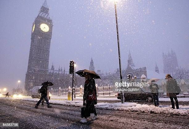 Commuters make their way through heavy snow in central London on February 2 2009 A blanket of snow covered large parts of western Europe Monday after...