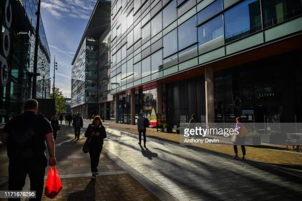 Commuters make their way through Media City ahead of a Labour Party shadow cabinet meeting and speech from labour party leader Jeremy Corbyn on...