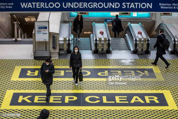 Commuters make their way through Waterloo Station on March 18 2020 in London England People have been encouraged to work from home and socially...