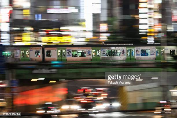 Commuters many wearing protective masks ride on a train on May 29 2020 in Tokyo Japan On May 25 Japanese government lifted the declaration on the...