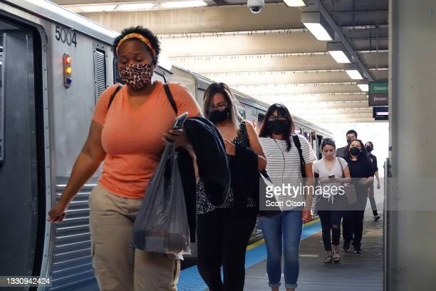 Commuters, most most of whom wear face masks, travel on the L train system in the Loop on July 27, 2021 in Chicago, Illinois. The Centers for Disease...