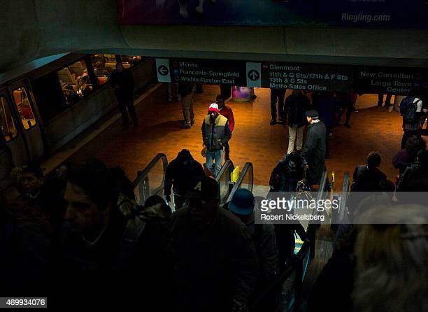 Commuters move to platforms for the next subway March 18, 2015 at the Metro Center station in Washington, DC.