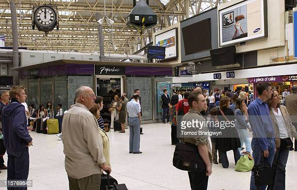 Commuters observe a two minutes silence at Waterloo Station in remembrance for those that lost their lives in the July 7 bombings