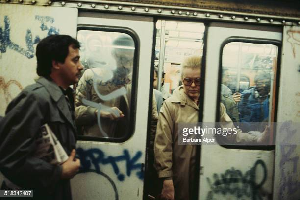 Commuters on a subway train in New York City USA circa 1980