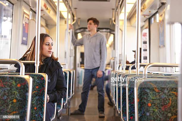 commuters on empty subway train - railroad car stock pictures, royalty-free photos & images