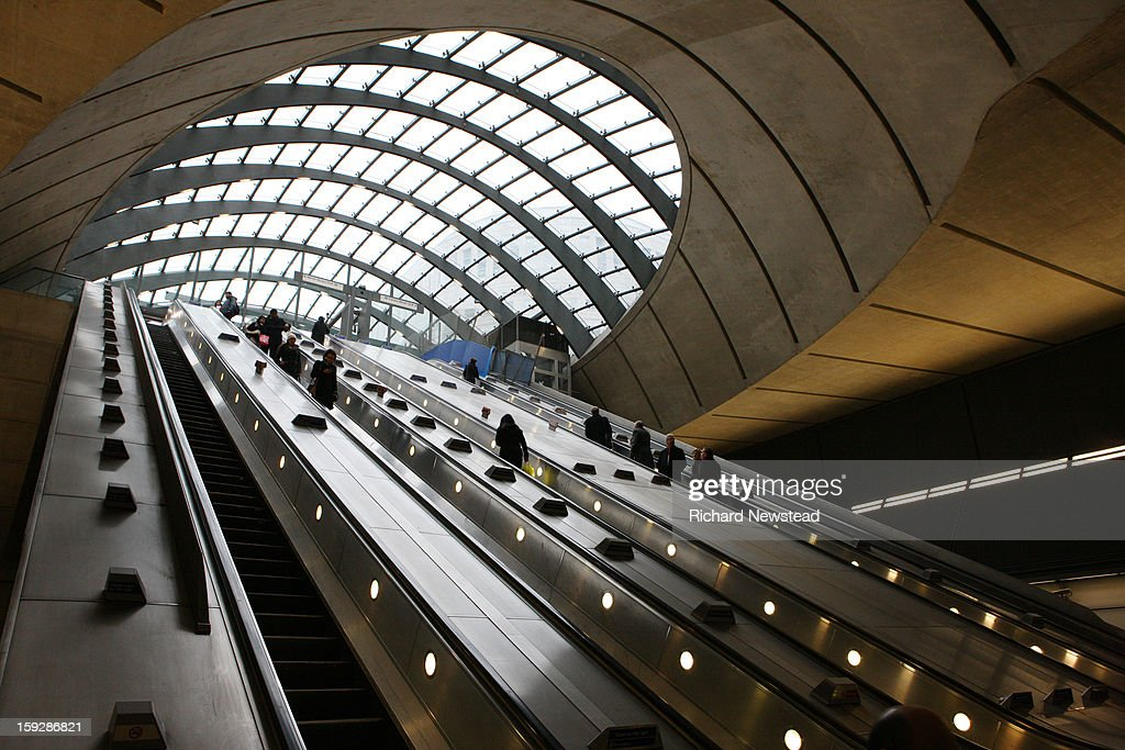 CONTENT] Commuters on escalators at Canary Wharf station. London 13th December 2012.