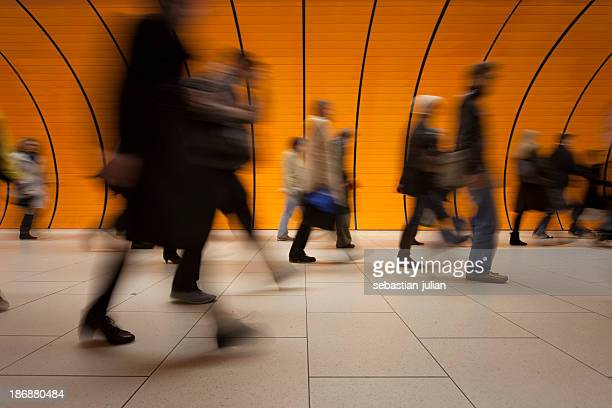 Commuters on modern subway with orange background