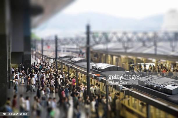 Commuters on platform boarding train