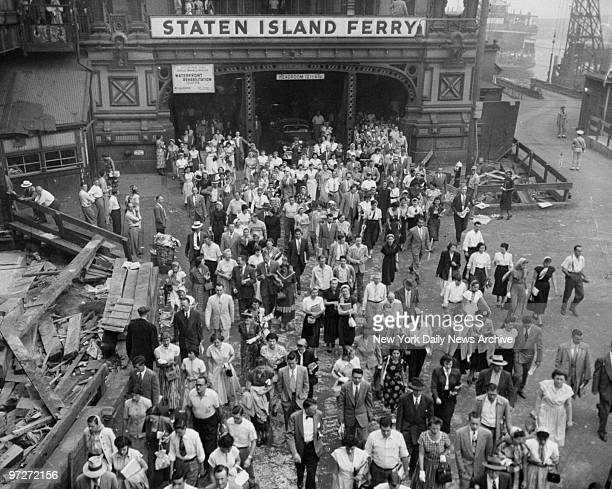 Commuters on their way to work in Manhattan pour out of the Staten Island Ferry Terminal at Battery Park