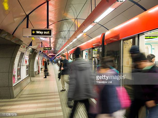 commuters on underground train, london - newpremiumuk stock pictures, royalty-free photos & images