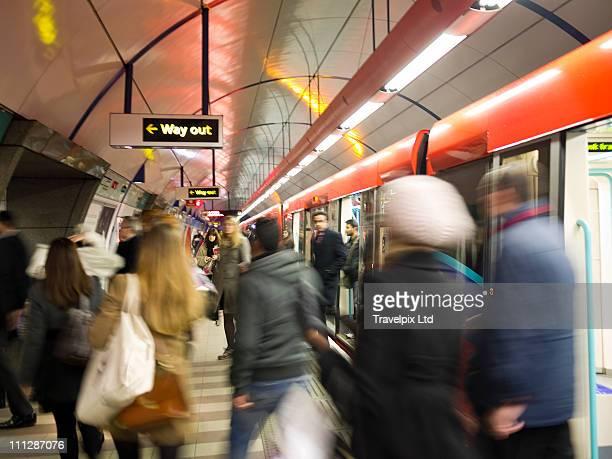commuters on underground train, london - ロンドン地下鉄 ストックフォトと画像