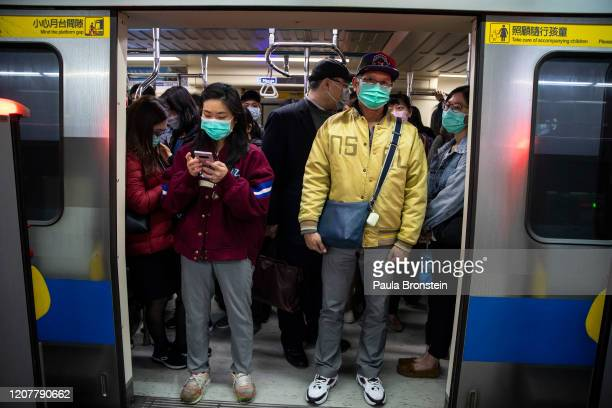 Commuters pack a metro train in downtownTaipei Taiwan on March 18 2020 in Taipei Taiwan Taiwan Singapore and Hong Kong have had more successful...