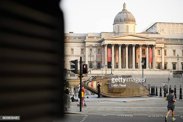 Commuters pass by a replica of a British Mark IV tank as it is displayed in Trafalgar Square on September 15 2016 in London England The tank is in...