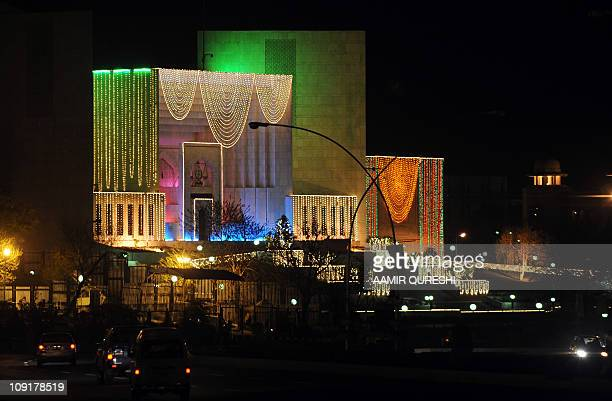 Commuters pass by the illuminated Pakistan Supreme Court building lit during celebrations marking the EideMiladunNabi the birth of Islam's Prophet...