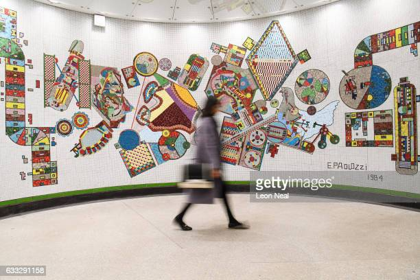 Commuters pass one of the restored mosaics by Eduardo Paolozzi in Tottenham Court Road underground station on February 1 2017 in London England...