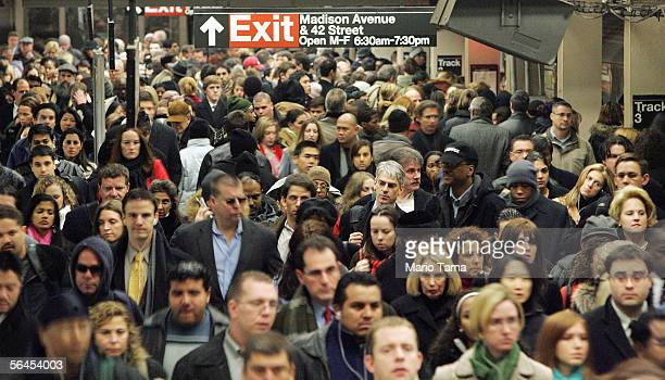 Commuters pass through Grand Central Terminal during morning rush hour December 19, 2005 in New York City. Transit workers continue to negotiate a...