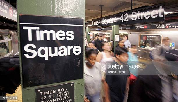 Commuters pass through Times Square subway station during the morning rush hour July 8 2005 in New York City Security on subway trains and buses was...