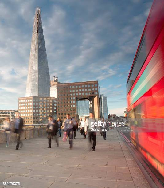 commuters. - london bridge stock pictures, royalty-free photos & images