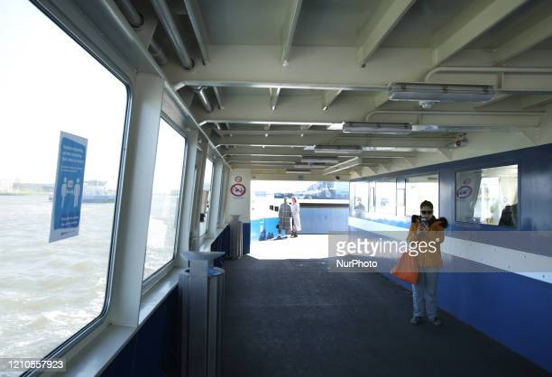Commuters practice social distancing and wait for their destination on the ferry at the IJ river near central station on April 20 2020 in...