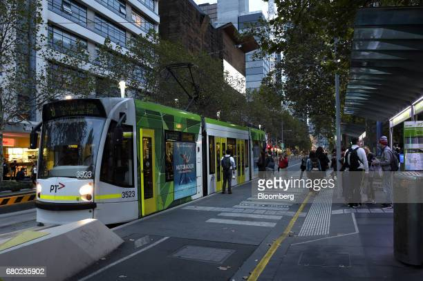 Commuters prepare to board a tram on Swanston Street in Melbourne Australia on Friday April 28 2017 Australia has some of the world's largest...