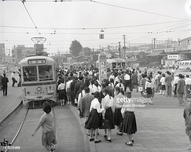 Commuters queue for a trum at Shibuya Station East Exit terminal on June 15 1960 in Tokyo Japan A large scale redevelopment around Shibuya station is...