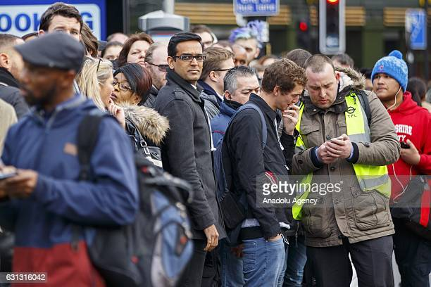 Commuters queue for buses outside King's Cross station as London Underground services are severely disrupted due to members of RMT and TSSA unions...
