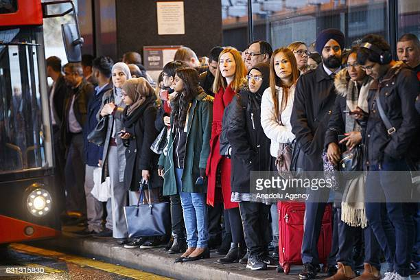 Commuters queue for buses outside London Euston station as London Underground services are severely disrupted due to members of RMT and TSSA unions...