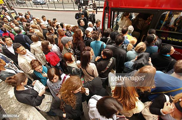 Commuters queue for buses outside Victoria Station during the RMT Union's tube strike on June 10 2009 in London England A 48 hour strike began at 7pm...
