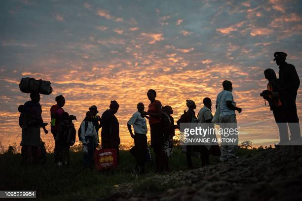 Commuters queue to purchase train tickets on January 29, 2019 in Cowdray Park township, in Bulawayo, Zimbabwe. - Zimbabwe's only commuter train is...